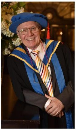 John Tempest, in academic garb, prior to receiving his Honorary Fellowship